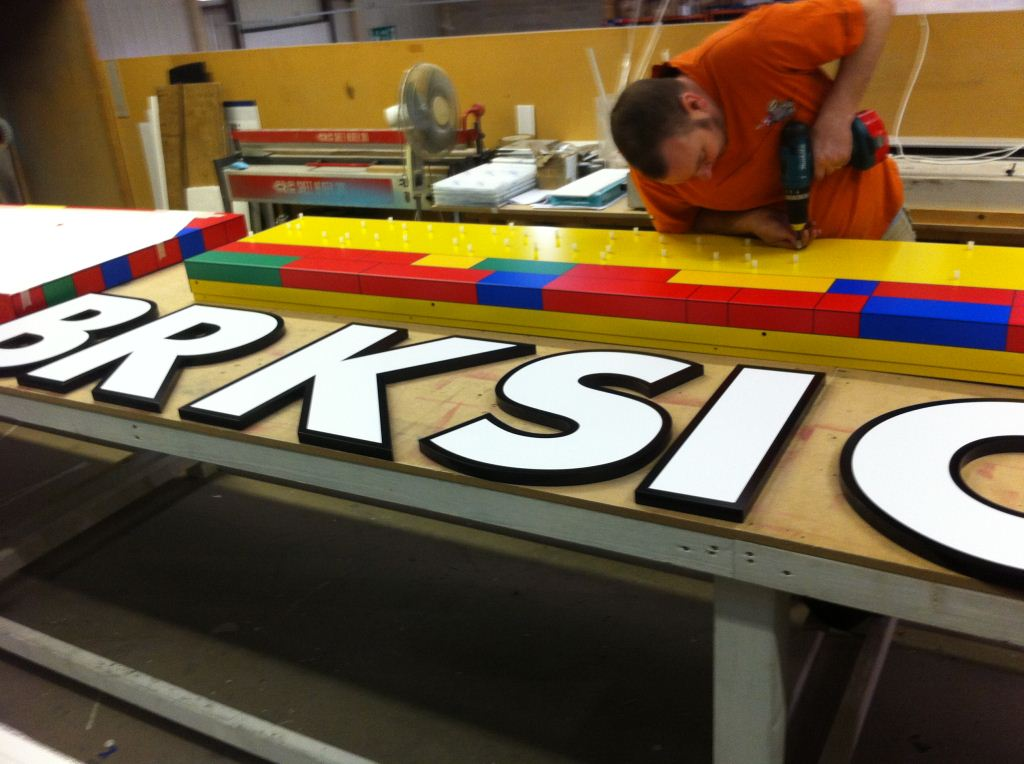 acrylic letters being cut