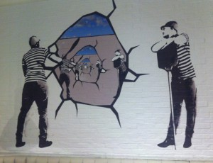 Wall vinyl showing people breaking down the wall