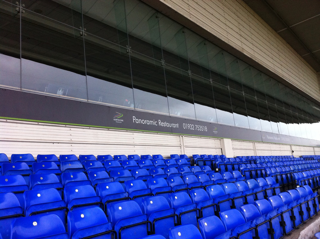 Arena seats with Kempton Park written on a banner behind